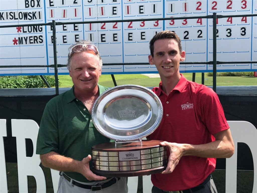 2017 World Am winner Curtis Henley of Poquoson, Va. (left) accepts the championship trophy from World Am Tournament Director Scott Tomasello.